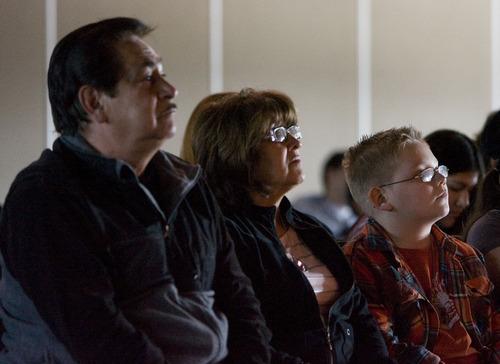 Steve Griffin     The Salt Lake Tribune Art and Mary Romo and grandson Christian Romo watch the Utah Shakespeare Festival's traveling production of