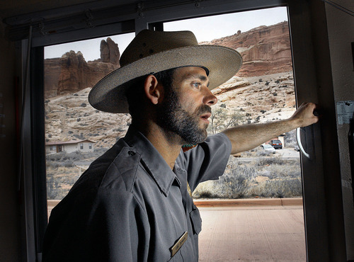 Scott Sommerdorf     The Salt Lake Tribune Park Ranger Eric Demuth waits for another visitor to drive up to the Arches entrance in Canyonlands National Park, Friday, April 8, 2011 in Moab, Utah. Almost every visitor to his window had questions about what the potential government shutdown might have on the operation of the park.