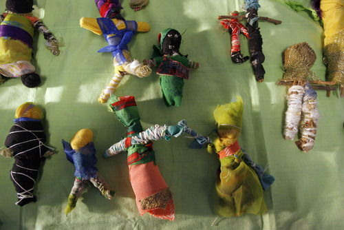 Francisco Kjolseth  |  The Salt Lake Tribune Dolls created by Uganda orphans will be part of a show April 15 that explores violence and brutality.