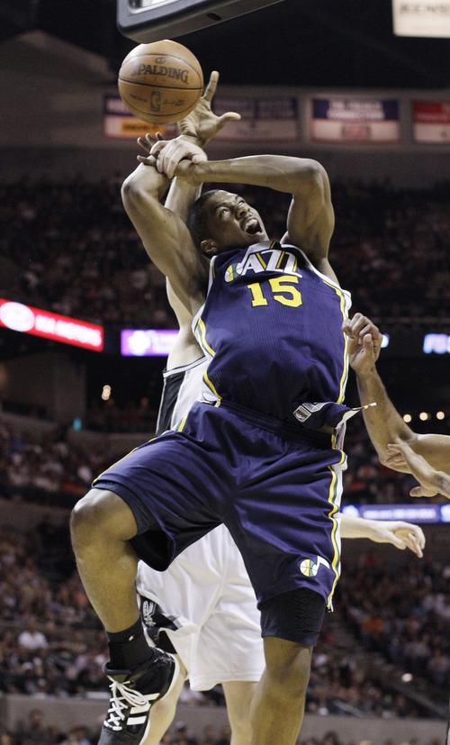Utah Jazz's Derrick Favors (15) is fouled by San Antonio Spurs' Matt Bonner during the first quarter of an NBA basketball game on Saturday, April 9, 2011, in San Antonio. (AP Photo/Eric Gay)