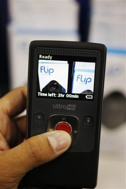 FILE - In this Nov. 4, 2009 file photo, a Cisco Systems' Flip Video camera is displayed at Best Buy in Mountain View, Calif. Cisco Systems Inc. is exiting parts of its consumer businesses, with plans to shut its Flip video camera business Tuesday, April 12, 2011.(AP Photo/Paul Sakuma)