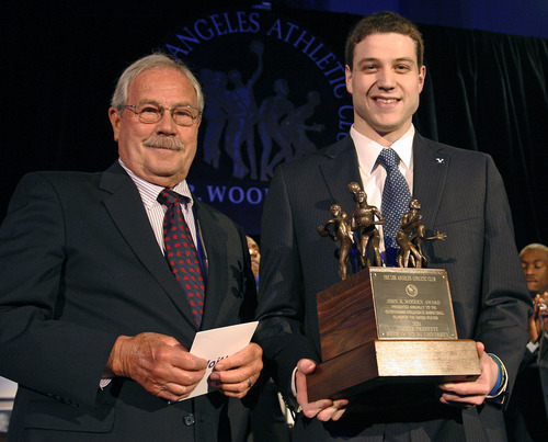 Jim Wooden, left, son of former UCLA basketball coach John Wooden, presents Jimmer Fredette of Brigham Young with the Men's John Wooden Award at the John R. Wooden Award ceremony on Friday, April 8, 2011, in Los Angeles. (AP Photo/Jason Redmond)