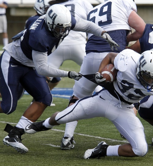 Rick Egan   |  The Salt Lake Tribune  Tavaris McMillian (16) left goes for a tackle during a USU spring scrimmage, at Romney Stadium, in Logan, Monday, April 11, 2011.
