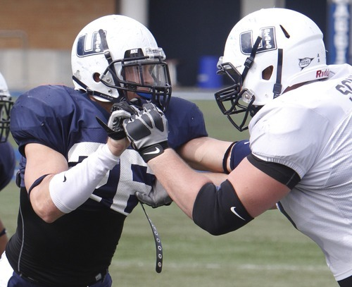Rick Egan   |  The Salt Lake Tribune   Gavin Jones (26) during a USU spring scrimmage, at Romney Stadium, in Logan, Monday, April 11, 2011.