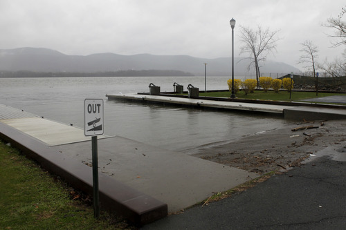 A boat ramp where a woman who drove her minivan into the Hudson River is seen in Newburgh, N.Y., Wednesday, April 13, 2011. The woman, who had just been involved in a domestic dispute, loaded her four children into a minivan Tuesday night before letting one out and driving the rest of them into the Hudson River, firefighters said. The woman and three young children were killed.  (AP Photo/Seth Wenig)