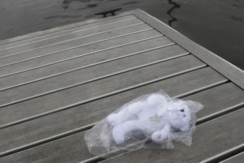 A teddy bear wearing a cross is seen next to the boat ramp where a woman drove her minivan into the Hudson River in Newburgh, N.Y., Wednesday, April 13, 2011. The woman, who had just been involved in a domestic dispute, loaded her four children into a minivan Tuesday night before letting one out and driving the rest of them into the Hudson River, firefighters said. The woman and three young children were killed.  (AP Photo/Seth Wenig)