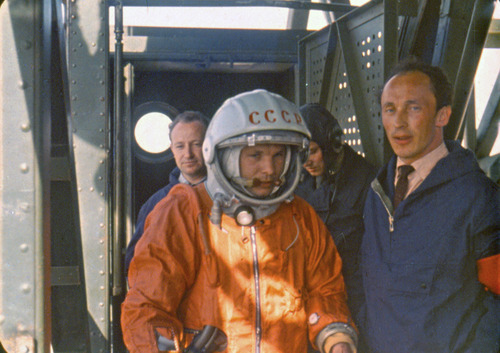 In this April 12 1961 photo, rocket engineer Oleg Ivanovsky, right, leads Yuri Gagarin, center, to the Vostok spacecraft before the launch from what will later become known as the Baikonur cosmodrome. Ivanovsky said that designers had done their best to make the first human flight into space safe, but risks were still high. People in the background are unidentified engineers.(AP photo/ NPO Lavochkin Museum, HO)