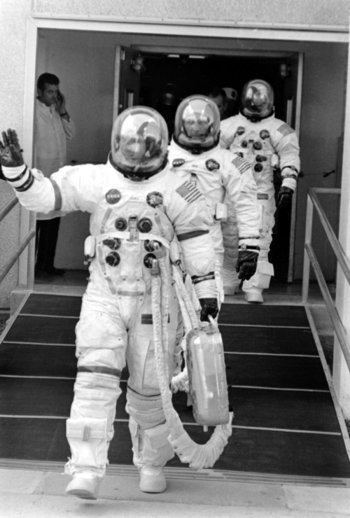 The crew of the Apollo 13 lunar landing mission are shown in their space suits on their way to the launch pad at Kennedy Space Center in Cape Kennedy, Fla., Saturday, April 11, 1970.  Flight Commander James A. Lovell Jr., is waving, followed by Lunar Module pilot John L. Swigert Jr., and Command Module pilot Fred W. Haise Jr.  An explosion on board forced Apollo 13 to circle the moon without landing.  (AP Photo/NASA)