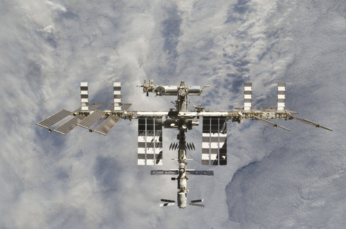 In this image provided by NASA the International Space Station is featured in this image photographed by an STS-133 crew member on space shuttle Discovery after the station and shuttle began their post-undocking relative separation. Undocking of the two spacecraft occurred at 7 a.m. (EST) on March 7, 2011.  (AP Photo/NASA)