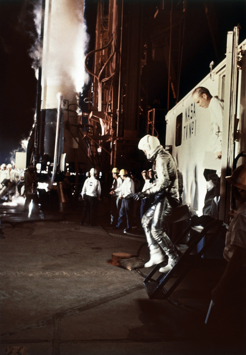 Alan Shepard, 37-year-old navy commander from East Derry, N. H., leaves NASA van to enter spacecraft, marking America's first manned flight on May 5, 1961. This was more than a month after Russia's Yuri Gagarin's orbit of the earth. (AP Photo)