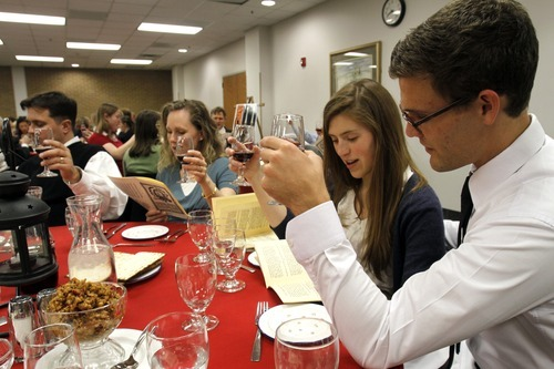 Rick Egan   |  The Salt Lake Tribune  Justin Jones, left, Jen Jones, Taylor Olson, and Kory Stevens participate in a Seder service at the WIlkinson Center at Brigham Young University, Saturday, April 9, 2011.  For nearly 40 years, BYU professor Victor L. Ludlow,  a specialist in Jewish studies, has been conducting the celebrations at BYU.