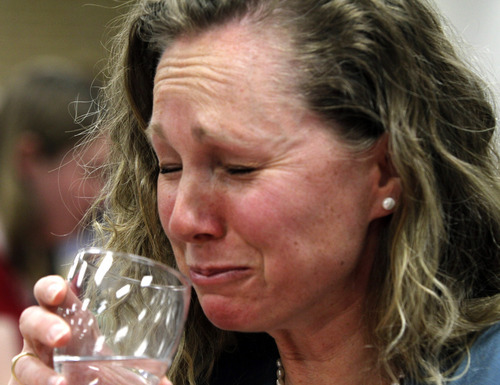 Rick Egan   |  The Salt Lake Tribune  Jen Jones reacts after eating the maror or bitter herb during a Seder service at the WIlkinson Center at Brigham Young University, Saturday, April 9, 2011.  For nearly 40 years, BYU professor Victor L. Ludlow,  a specialist in Jewish studies, has been conducting the celebrations at BYU.