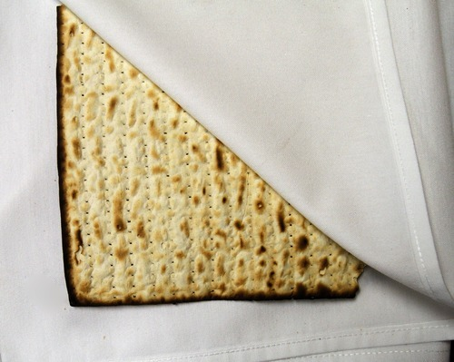 Rick Egan   |  The Salt Lake Tribune  Matzah or unleavened bread is used during a Seder service at the WIlkinson Center at Brigham Young University, Saturday, April 9, 2011.  For nearly 40 years, BYU professor Victor L. Ludlow,  a specialist in Jewish studies, has been conducting the celebrations at BYU.