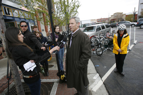 Francisco Kjolseth  |  The Salt Lake Tribune Salt Lake City Mayor Ralph Becker speaks with the media during the unveiling of the city's first bike corral in front of Squatters Pub Brewery on Thursday.
