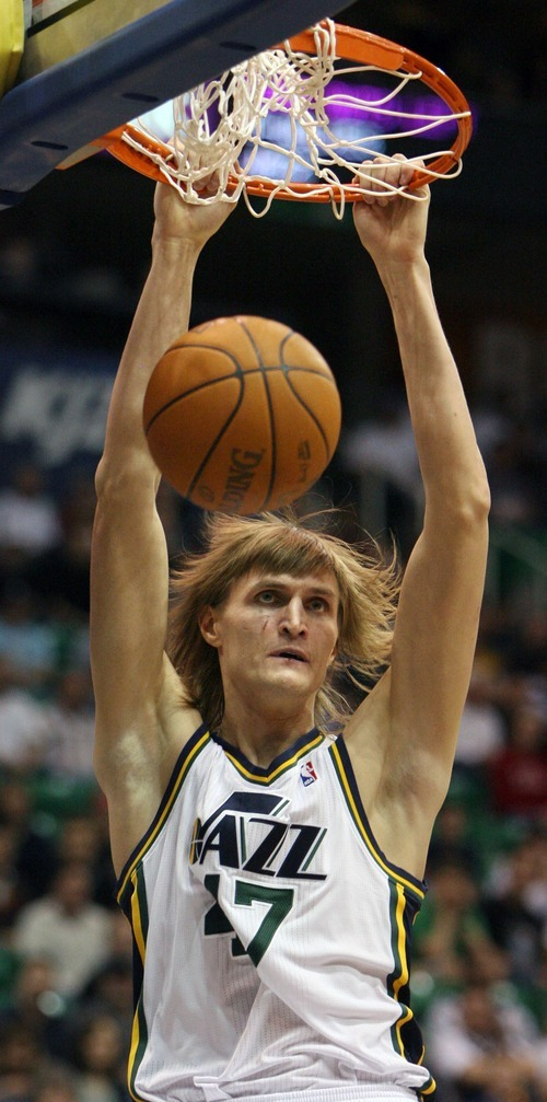 Steve Griffin  |  The Salt Lake Tribune   Utah Jazz forward Andrei Kirilenko with a two-handed dunk during a game against the Timberwolves at EnergySolutions Arena  in Salt Lake City on Wednesday, March 16, 2011.