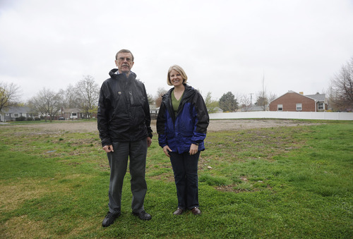 Sarah A. Miller  |  The Salt Lake Tribune  Neighbors Ben Burdett and Sally Barraclough stand in the vacant lot they hope to buy from the LDS church to build a neighborhood park. They plan to raise money to purchase the land and build a playground.