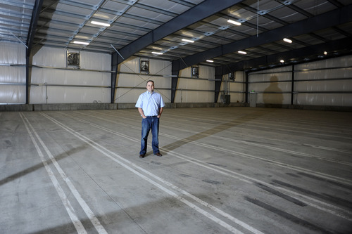 Sarah A. Miller  |  The Salt Lake Tribune  Shawn Hartley, one of three owners of Utah Onion stands in a large storage room build last summer for winter onion storage at his Syracuse business. If the proposed West Davis Corridor plan is approved their suppliers would lose onion fields so Utah Onion would not have the need for such large storage room.