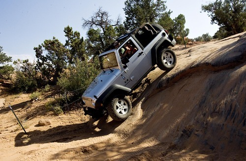 Djamila Grossman  |  The Salt Lake Tribune  Rob Covert drives a Jeep on the Fins & Things 4x4 trail near Moab on Saturday, Oct. 2, 2010.