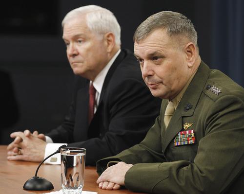 Defense Secretary Robert Gates, left, and Joint Chiefs Vice Chairman Gen. James Cartwright take part in a media availability at the Pentagon, Thursday, April 21, 2011. (AP Photo/Alex Brandon)