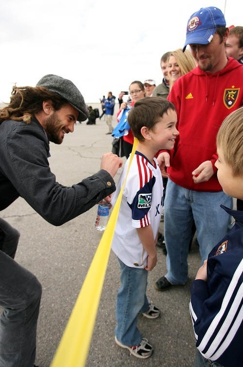 Leah Hogsten  |  The Salt Lake Tribune Real Salt Lake's Kyle Beckerman signs the shirt of Kobi Bird. Real Salt Lake was greeted by about 60 fans when the team landed at Million Air Terminal in Salt Lake City on Thursday, April 21, 2011. The Major League Soccer team returned from a 2-2 tie Wednesday against Mexican champions Monterrey in the first leg of the CONCACAF Champions League Final.