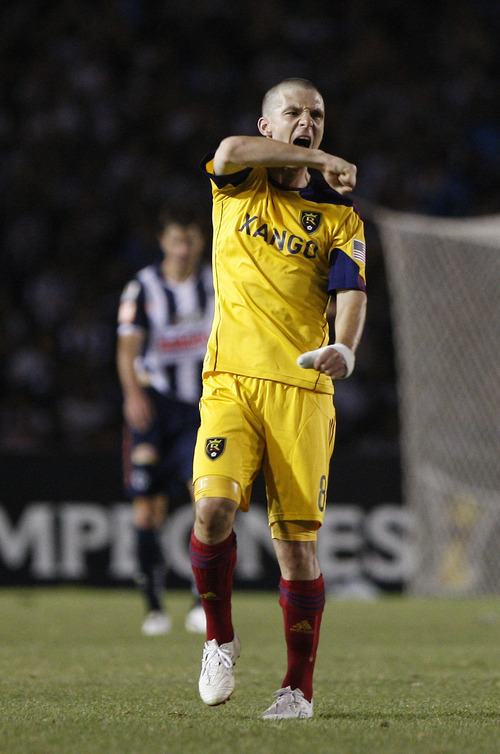 U.S. Real Salt Lake's Will Johnson celebrates after his teammate Javier Morales, not in picture, scored during the Concacaf Champions League first leg final soccer match against Monterrey in Monterrey, Mexico, Wednesday, April 20, 2011. (AP Photo/Miguel Tovar)