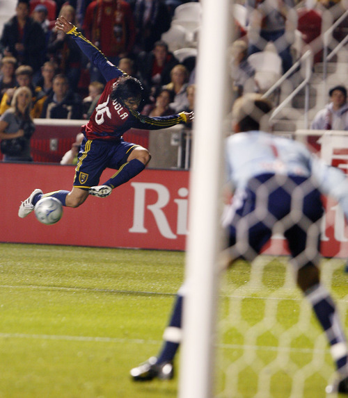 Real Salt Lake's Fabian Espindola leaps through the air as he tries to center the ball during RSL's 2-0 win over New York at Rio Tinto Stadium.    Steve Grifffin  |  The Salt Lake Tribune