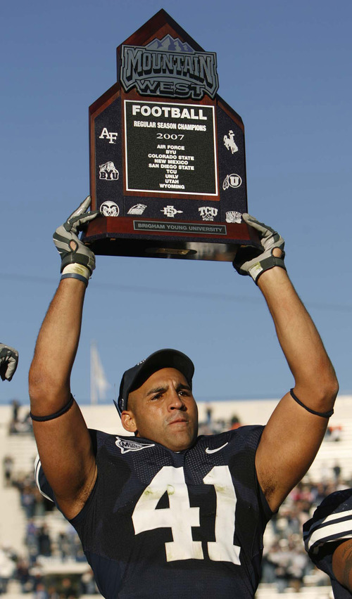 Trent Nelson | The Salt Lake Tribune  Brigham Young linebacker Bryan Kehl holds aloft the Mountain West Conference trophy after BYU defeated the Utah 17-10. 11.24.2007