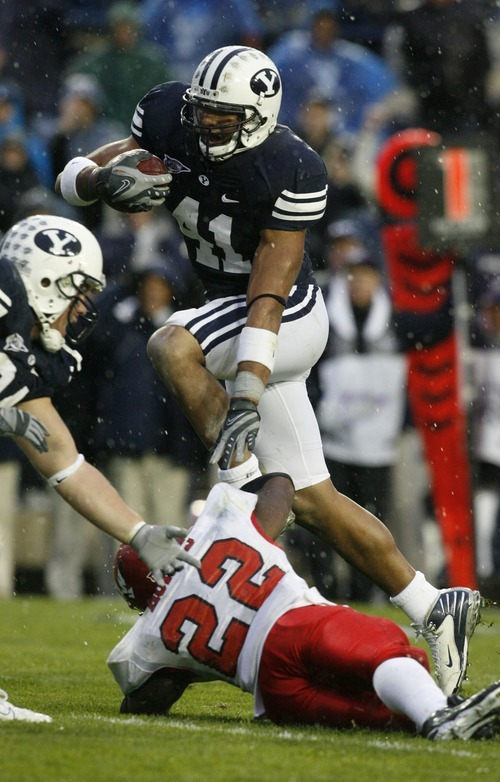 Rick Egan | The Salt Lake Tribune    Bryan Kehl leaps over Dale Morris, as he runs the ball after a pass interception for the Cougars,   in Mountain West football action, BYU vs Eastern Washington at Lavell Edwards Stadium in Provo.   10/20/2007