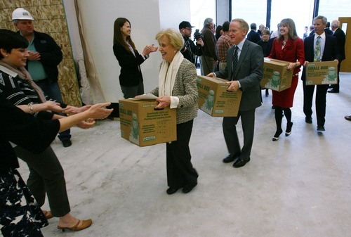 Steve Griffin  |  The Salt Lake Tribune  Beverley Taylor Sorenson, her son Jim Sorenson, Dee Moooney, of The Micron Foundation, and Salt Lake City mayor Ralph Becker carry ceremonial boxes into The Leonardo during a move-in day event at The Leonardo in Salt Lake City on Monday, April 25, 2011.  The Sorenson Legacy Foundation and The Micron Foundation are major donors to The Leodnardo.