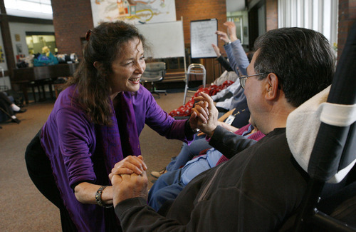 Francisco Kjolseth  |  The Salt Lake Tribune Lyn Koshland, a board certified dance and movement therapist, uses touch to connect with clients of the Riverside Neighborhood adult day center in Salt Lake on Thursday, April 21, 2011. The Neighborhood house, which provides social services to children, homeless adults and people with Alzheimer's and other such disabilities, has had big cuts to its early-childhood funding. This could affect some of the intergenerational programs the nonprofit has offered.