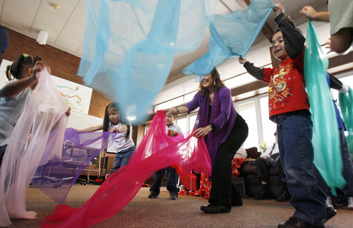 Francisco Kjolseth  |  The Salt Lake Tribune Lyn Koshland, second from right, a board-certified dance and movement therapist, brings preschoolers and seniors together as they interact through music and color at Riverside Neighborhood adult day center in Salt Lake City. Neighborhood House received $5,000 from Murray City's Community Development Block Grant to help Alzheimer's caregivers.
