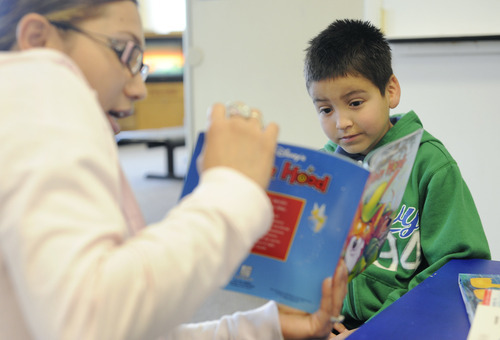 Sarah A. Miller     The Salt Lake Tribune  Medical assistant Eldy Baltodoano reads a book to patient Oscar Izarraraz, 7, of Midvale, in the Reach Out and Read area in the waiting room before his appointment at Oquirrh View Community Health in Taylorsville Monday April 25, 2011.