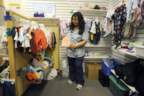 Sarah A. Miller     The Salt Lake Tribune  Clinical care coordinator Emily Garcia displays some of the donated items available at the Teddy Bear Den store for expecting mothers at Oquirrh View Community Health in Taylorsville Monday April 25, 2011.