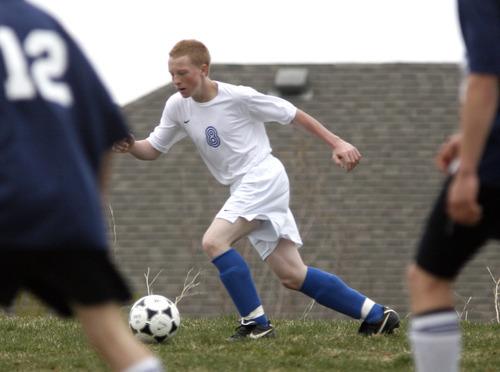Rick Egan   |  The Salt Lake Tribune Dane Dickerson, 8, kicks the ball for Salt Lake Lutheran, in the final game of the season. West Ridge won the game 4-0.