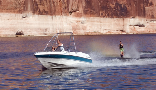 TRIBUNE FILE PHOTO A water skier enjoys a ride from a boat at Lake Powell in this file photo. A new Interior Department report says the Colorado River Basin likely will lose about 9 percent of its annual in the next 40 years because of climate change.