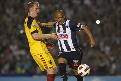 Mexico's Monterrey's Humberto Suazo, right, dribbles past U.S. Real Salt Lake's Nate Borchers during the Concacaf Champions League first leg final soccer match in Monterrey, Mexico, Wednesday, April 20, 2011. (AP Photo/Miguel Tovar)