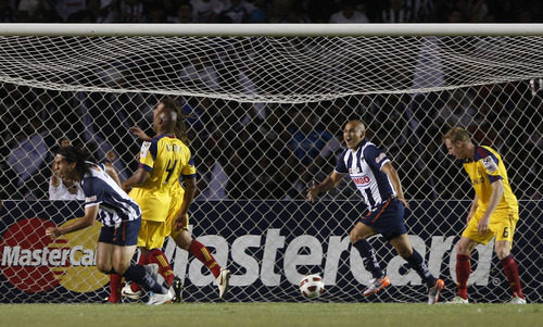 Mexico's Monterrey's Aldo De Nigris, left, celebrates after scoring during the Concacaf Champions League first leg final soccer match against U.S. Real Salt Lake in Monterrey, Mexico, Wednesday, April 20, 2011. The match ended 2-2. (AP Photo/Miguel Tovar)