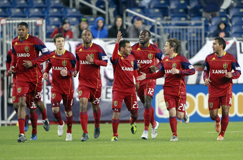 Associated Press file photo Jean Alexandre, pictured third from left in this file photo taken in Foxborough, Mass., scored his first professional goal and assisted on another to lead Real Salt Lake to a 2-0 victory over the Vancouver Whitecaps at Rio Tinto Stadium on Saturday night.