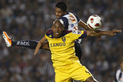 Mexico's Monterrey's Sergio Santana, top, and U.S. Real Salt Lake Jamison Olave go for a header during the Concacaf Champions League first leg final soccer match in Monterrey, Mexico, Wednesday, April 20, 2011. (AP Photo/Miguel Tovar)