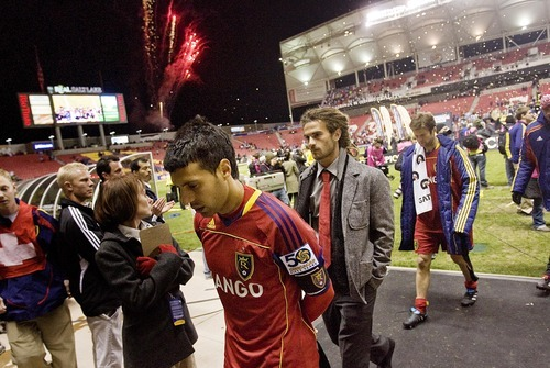 Djamila Grossman     The Salt Lake Tribune  Real Salt Lake's Javier Morales and his teammates walk off the field after they lost against Monterrey in the CONCACAF Champions League final in Sandy on Wednesday, April 27, 2011.