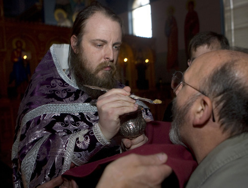 Al Hartmann   |  The Salt Lake Tribune  Fr. Justin Havens, an Antiochian Orthodox priest,  serves communion of bread soaked in wine in a chalice with an ornate silver spoon at Saints Peter and Paul Antiochan Orthodox Christian Church in Salt Lake City.
