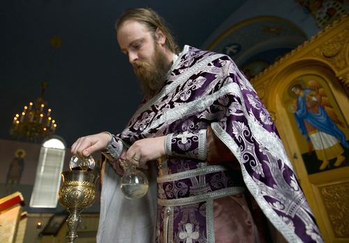 Al Hartmann   |  The Salt Lake Tribune  Fr. Justin Havens, an Antiochian Orthodox priest, demonstrates mixing of water and wine into a chalice for communion.   Bread is soaked in the chalice and served on an ornate silver spoon at Saints Peter and Paul Antiochan Orthodox Christian Church in Salt Lake City.