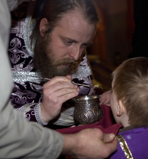 Al Hartmann   |  The Salt Lake Tribune  Fr. Justin Havens, an Antiochian Orthodox priest, serves communion of bread soaked in wine in a chalice with an ornate silver spoon at Saints Peter and Paul Antiochian Orthodox Christian Church  in Salt Lake City.
