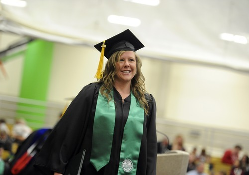 Sarah A. Miller  |  The Salt Lake Tribune  Mallorie Coffin walks across the stage after receiving her diploma at the Utah Valley University College of Science and Health convocation ceremony Friday morning April 29, 2011.