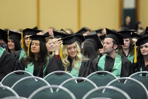 Sarah A. Miller  |  The Salt Lake Tribune  Nursing student Angela Chamberlain, center, fixes her tassel as she waits for her turn to walk at the Utah Valley University College of Science and Health convocation ceremony Friday morning April 29, 2011.