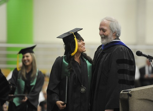 Sarah A. Miller  |  The Salt Lake Tribune  Jenny Demas of St. George shakes hands with dean Sam Rushforth after receiving her degree in exercise science at the Utah Valley University College of Science and Health convocation ceremony Friday morning April 29, 2011.