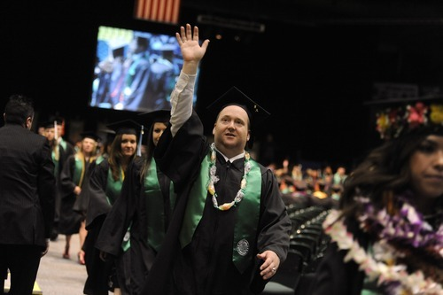 Sarah A. Miller  |  The Salt Lake Tribune  Stephen Neal of Pleasant Grove waves to family as leaves the Utah Valley University commencement ceremony Friday, April 29, 2011.