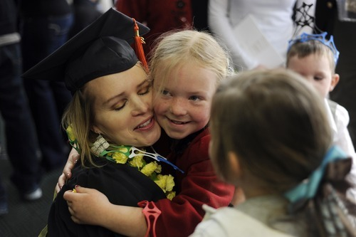 Sarah A. Miller  |  The Salt Lake Tribune  Graduate Melody Evans of Sandy is hugged by her daughter McKenna, 9, after her graduation at the Utah Valley University Friday, April 29, 2011. Evans graduated with a bachelors in digital media project management.