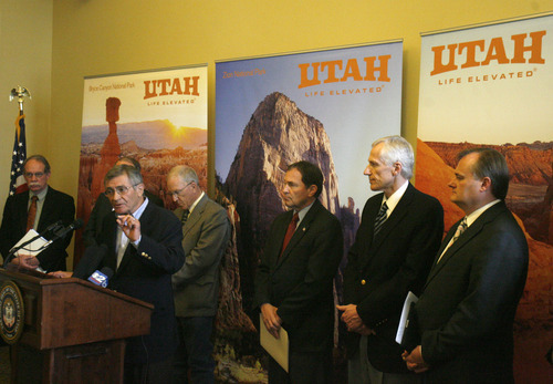 Rick Egan   |  The Salt Lake Tribune Ted Wilson, Gov. Gary Herber's environmental adviser, joins Utah officials in announcing the state's lawsuit Friday against the federal wild lands policy.