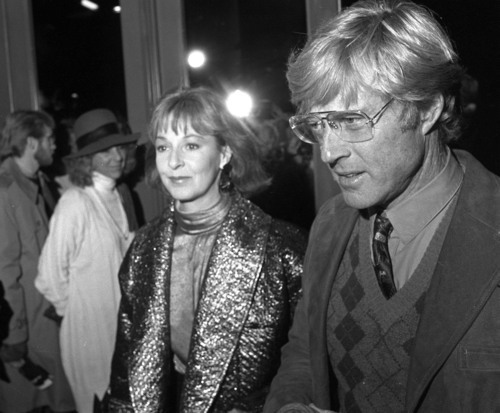 Robert Redford and Jane Alexander during a movie premiere in 1987.